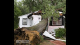 In this Monday, July 22, 2019, photo provided by the Neptune Township OEM and Special Operations, a tree crashed through a home during a severe storm in Neptune Township, N.J. Hundreds of thousands of people in New Jersey are without power after powerful storms blew across the state Monday. The storms packed wind gusts of 60 to 70 mph and downed trees and power lines. Several trees fell on homes across the region, though no injuries were reported. (Donald Colarruso/Neptune Township OEM and Special Operations via AP)