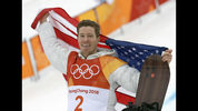 """FILE - In this Feb. 14, 2018, file photo, gold medal winner Shaun White celebrates after the men's halfpipe finals at the 2018 Winter Olympics in Pyeongchang, South Korea. Shaun White is pressing forward with plans to shoot for the Summer Olympics in skateboarding. White said Tuesday, July 23, 2019, on NBC's """"Today"""" show that he'll compete at world championships in September """"and see what happens"""" before deciding whether to try to earn a spot on the U.S. team for skateboarding's Olympic debut next summer in Tokyo.(AP Photo/Lee Jin-man, File)"""