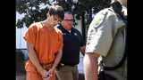 """Brandon Theesfeld, left, is led from the Lafayette County Courthouse in Oxford, Miss., Tuesday, July 23, 2019 by Maj. Alan Wilburn, after being arraigned in connection with the death of 21-year-old University of Mississippi student Alexandria """"Ally"""" Kostial. (Bruce Newman/The Oxford Eagle via AP)"""