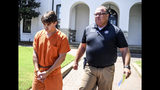 "Brandon Theesfeld, left, is led from the Lafayette County Courthouse in Oxford, Miss., Tuesday, July 23, 2019, by Maj. Alan Wilburn, after being arraigned in connection with the death of 21-year-old University of Mississippi student Alexandria ""Ally"" Kostial. (Bruce Newman/The Oxford Eagle via AP)"