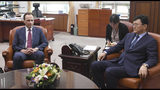 Acting Russian Ambassador to South Korea Maxim Volkov, left, and South Korean Deputy Minister for Political Affairs Yoon Soon-gu take their seats before their meeting at the Foreign ministry in Seoul, South Korea, Tuesday, July 23, 2019. Yoon on Tuesday summoned Volkov to protest the countries' military jets entering South Korea's airspace. (Kim Sung-do/Yonhap via AP)