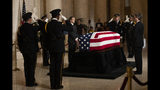 Honor guards salute as they execute the changing of the guard in the Great Hall of the U.S. Supreme Court where the late Supreme Court Justice John Paul Stevens is laying in repose, Monday, July 22, 2019, in Washington. (AP Photo/Manuel Balce Ceneta)