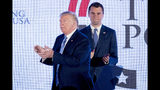 President Donald Trump is joined on stage with Turning Point USA Founder Charlie Kirk as he finishes speaking at Turning Point USA Teen Student Action Summit at the Marriott Marquis in Washington, Tuesday, July 23, 2019. (AP Photo/Andrew Harnik)