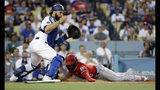 Los Angeles Angels' Luis Rengifo, right, scores past Los Angeles Dodgers catcher Russell Martin on a single by Shohei Ohtani during the second inning of a baseball game Tuesday, July 23, 2019, in Los Angeles. (AP Photo/Marcio Jose Sanchez)