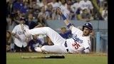 Los Angeles Dodgers' Cody Bellinger scores on a sacrifice fly from Corey Seager during the fourth inning of a baseball game against the Los Angeles Angels, Tuesday, July 23, 2019, in Los Angeles. (AP Photo/Marcio Jose Sanchez)