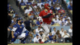 Los Angeles Angels' Shohei Ohtani drives in a run with a single during the second inning of a baseball game against the Los Angeles Dodgers Tuesday, July 23, 2019, in Los Angeles. (AP Photo/Marcio Jose Sanchez)