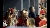 Los Angeles Angels' Mike Trout, center, celebrates his solo home run with teammates in the dugout during the fifth inning of a baseball game against the Los Angeles Dodgers, Tuesday, July 23, 2019, in Los Angeles. (AP Photo/Marcio Jose Sanchez)