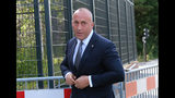 Former Kosovo Prime Minister Ramush Haradinaj arrives for a Kosovo tribunal, at the Hague, Netherlands, Wednesday, July 24, 2019. Haradinaj will be questioned by a special court investigating alleged war crimes by members of the separatist Kosovo Liberation Army two decades ago. (AP Photo/Michael Corder)