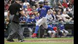 El jugador de los Rangers de Texas Rougned Odor anota contra los Marineros de Seattle en el segundo inning de su juego de béisbol, el martes 23 de julio de 2019 en Seattle. (AP Foto/Elaine Thompson)