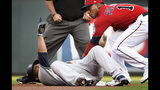New York Yankees' Edwin Encarnacion, left, lays at second base for a double as Minnesota Twins' Jorge Polanco, right, attempts the tag in the first inning of a baseball game, Tuesday, July 23, 2019, in Minneapolis. (AP Photo/Tom Olmscheid)