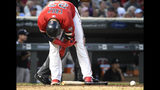 Minnesota Twins' Nelson Cruz grabs his elbow after being hit by New York Yankees pitcher Domingo German in the fourth inning of a baseball game, Tuesday, July 23, 2019, in Minneapolis. Cruz was the second Twin hit by Yankees pitcher Domingo German in the game. (AP Photo/Tom Olmscheid)