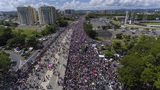 Demonstrators march on Las Americas highway demanding the resignation of governor Ricardo Rossello, in San Juan, Puerto Rico, Monday, July 22, 2019. Protesters are demanding Rossello step down for his involvement in a private chat in which he used profanities to describe an ex-New York City councilwoman and a federal control board overseeing the island's finance. (AP Photo/Gianfranco Gaglione)