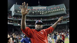 FILE - In this Oct. 10, 2016, file photo, Boston Red Sox's David Ortiz waves from the field at Fenway Park after Game 3 of baseball's American League Division Series against the Cleveland Indians in Boston. Former Red Sox slugger David Ortiz is out of the hospital following three surgeries after being shot in the back at a bar in the Dominican Republic. The Red Sox said on Saturday, July 27, 2019 that they've been told Ortiz has been released from Massachusetts General Hospital. The team said there will be an update on his condition next week. (AP Photo/Charles Krupa, File)