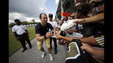 New Orleans Saints quarterback Drew Brees signs autographs for fans after training camp at their NFL football training facility in Metairie, La., Monday, July 29, 2019. (AP Photo/Gerald Herbert)