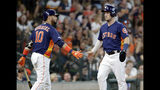 Houston Astros first baseman Yuli Gurriel (10) congratulates Alex Bregmam, right, after he scored on the hit by Carlos Correa during the fourth inning of a baseball game against the Seattle Mariners Sunday, Aug. 4, 2019, in Houston. (AP Photo/Michael Wyke)