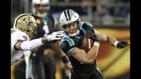 FILE - In this Dec. 17, 2018, file photo, Carolina Panthers' Christian McCaffrey, right, tries to run past New Orleans Saints' Marcus Williams in the second half of an NFL football game in Charlotte, N.C. Second-team All-Pro running back Christian McCaffrey had 326 touches last season and the Panthers want to increase that number even more this year _ all while cutting his overall number of plays on the field. (AP Photo/Jason E. Miczek, File)