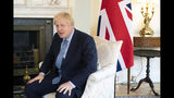 Britain's Prime Minister Boris Johnson, ahead of official talks with Estonian Prime Minister Juri Ratas, inside 10 Downing Street, London, Tuesday Aug. 6, 2019. (Dominic Lipinski/Pool via AP)