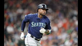 FILE - In this June 29, 2019, file photo, Seattle Mariners' Tim Beckham runs the bases after hitting a two-run home run against the Houston Astros during the second inning of a baseball game, in Houston. Seattle Mariners infielder Tim Beckham has been suspended 80 games as part of baseball's joint drug agreement after testing positive for stanozolol, a banned performance-enhancer, Major League Baseball announced Tuesday, Aug. 6, 2019. Beckham's suspension is effective immediately and ends his season. (AP Photo/David J. Phillip, File)