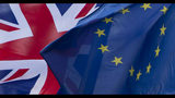 FILE- In this Dec. 8, 2017 file photo, UK's Union Flag, left, and the EU flag, flap in the wind outside EU headquarters in Brussels. On Thursday, Aug. 1, 2019 the European Union has told Britain's new Europe adviser David Frost that it is not prepared to renegotiate the Brexit agreement, three months before the country is due to leave the 28-nation bloc. (AP Photo/Virginia Mayo, File)