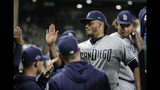 San Diego Padres starting pitcher Dinelson Lamet, second from right, is greeted in the dugout after finishing the seventh inning of a baseball game against the Seattle Mariners, Tuesday, Aug. 6, 2019, in Seattle. Lamet had a no-hitter broken up during the inning by Mariners' Omar Narvaez, who singled. (AP Photo/Ted S. Warren)