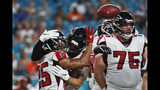 Atlanta Falcons running back Ito Smith (25) is congratulated by tight end Eric Saubert, center, after scoring a touchdown during the first half of the team's preseason NFL football game against the Miami Dolphins, Thursday, Aug. 8, 2019, in Miami Gardens, Fla. (AP Photo/Brynn Anderson)