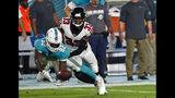 Miami Dolphins wide receiver Preston Williams (82) makes a catch in front of Atlanta Falcons cornerback Blidi Wreh-Wilson (33) during the first half of a preseason NFL football game Thursday, Aug. 8, 2019, in Miami Gardens, Fla. (AP Photo/Brynn Anderson)