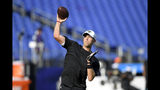 Jacksonville Jaguars quarterback Nick Foles works out prior to the team's NFL football preseason game against the Baltimore Ravens, Thursday, Aug. 8, 2019, in Baltimore. (AP Photo/Nick Wass)