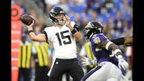 Jacksonville Jaguars quarterback Gardner Minshew looks to pass against the Baltimore Ravens during the first half of an NFL football preseason game Thursday, Aug. 8, 2019, in Baltimore. (AP Photo/Nick Wass)