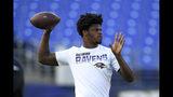 Baltimore Ravens quarterback Lamar Jackson works out prior to an NFL football preseason game against the Jacksonville Jaguars, Thursday, Aug. 8, 2019, in Baltimore. (AP Photo/Nick Wass)