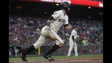 San Francisco Giants' Brandon Belt watches his single that scored Brandon Crawford against the Philadelphia Phillies during the third inning of a baseball game in San Francisco, Thursday, Aug. 8, 2019. (AP Photo/Jeff Chiu)