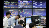 Currency traders work at the foreign exchange dealing room of the KEB Hana Bank headquarters in Seoul, South Korea, Thursday, Aug. 8, 2019. Asian stocks rebounded Thursday after Wall Street eked out a gain following volatility fueled by concern fallout from the U.S.-Chinese trade war will spread. (AP Photo/Ahn Young-joon)