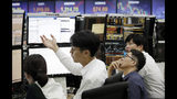 Currency traders watch monitors at the foreign exchange dealing room of the KEB Hana Bank headquarters in Seoul, South Korea, Thursday, Aug. 8, 2019. Asian stocks rebounded Thursday after Wall Street eked out a gain following volatility fueled by concern fallout from the U.S.-Chinese trade war will spread. (AP Photo/Ahn Young-joon)