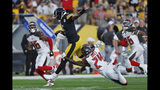 Pittsburgh Steelers quarterback Joshua Dobbs, center, is tackled after a long run by Tampa Bay Buccaneers strong safety Kentrell Brice (24) during the first half of an NFL preseason football game in Pittsburgh, Friday, Aug. 9, 2019. (AP Photo/Keith Srakocic)