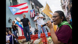 Protesters gather outside the government mansion La Fortaleza in San Juan, Puerto Rico, Wednesday, Aug. 7, 2019, calling for the removal of the island's newly sworn-in governor. Justice Secretary Wanda Vazquez took the oath of office early Wednesday evening at the Puerto Rican Supreme Court, which earlier in the day ruled that Pedro Pierluisi's swearing in last week was unconstitutional. (AP Photo/Dennis M. Rivera Pichardo)