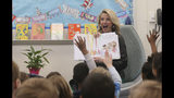 "FILE-- In this March 1, 2019 file photo first partner, Jennifer Siebel Newsom, the wife of Gov. Gavin Newsom, reads the book ""Ada Twist, Scientist"" by Andrea Beaty and David Roberts, to kindergarteners at the Washington Elementary School in Sacramento, Calif. Siebel Newsom visited the school, with her husband to celebrate Read Across America Day. She often attends events with her husband but also works on issues of her own including equal rights for women. (AP Photo/Rich Pedroncelli, File)"