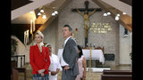 FILE-- In this April 9, 2019 file photo California Gov. Gavin Newsom, right, and his wife, Jennifer Siebel Newsom, left, visit the Divine Providence Chapel where Monsignor Oscar Arnulfo Romero was assassinated by a gunman in 1980, during a part of their three-day visit in San Salvador, El Salvador. Siebel Newsom often attends events with her husband but also works on issues of her own including equal rights for women. (AP Photo/Salvador Melendez, File)