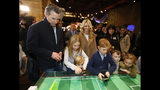 FILE -- In this Jan. 6, 2019 file photo Governor-elect, Lt. Gov. Gavin Newsom, left, and his wife, Jennifer Siebel Newsom, center, watch their children, daughter Montana, second from left, and sons, Dutch, foreground and Hunter, foreground fourth from left, operate robot games during an Inaugural Family Event at the California Railroad Museum, Sacramento, Calif. Since the inaugural, Siebel Newsom often attends events with her husband but also works on issues of her own including equal rights for women. (AP Photo/Rich Pedroncelli, File)