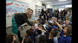 FILE-- IN this March 1, 2019 file photo first partner, Jennifer Siebel Newsom, the wife of Gov. Gavin Newsom, is greeted by kindergarteners at the Washington Elementary School in Sacramento, Calif. Siebel Newsom visited the school, with her husband to celebrate Read Across America Day. Siebel Newsom often attends events with her husband but also works on issues of her own including equal rights for women. (AP Photo/Rich Pedroncelli, File)