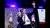 "FILE -- In this Nov. 6, 2018 file photo Lt. Gov Gavin Newsom, a Democrat, hugs his wife,Jennifer Siebel Newsom as he celebrates at an election night party after he defeated Republican opponent John Cox to become 40th governor of California, in Los Angeles, Calif. Siebel Newsom has shunned the traditional title of ""first lady"" and is focusing on women's issues including equal pay and expanding family leave. (AP Photo/Rich Pedroncelli, File)"