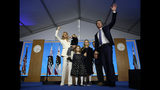 "FILE -- In this Jan. 7, 2019 file photo, California Governor Gavin Newsom, his wife, Jennifer Siebel Newsom, and family waves after taking the oath office during his inauguration as 40th Governor of California, Sacramento, Calif. Siebel Newsom has shunned the traditional title of ""first lady"" and is focusing on women's issues including equal pay and expanding family leave. (AP Photo/Rich Pedroncelli, File)"
