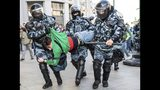 Police detain a man during a protest in Moscow, Russia, Saturday, Aug. 10, 2019. Tens of thousands of people rallied Saturday against the exclusion of some city council candidates from Moscow's upcoming election, turning out for one of the Russian capital's biggest political protests in years. After the rally, which was officially sanctioned, hundreds of participants streamed to an area near the presidential administration building to continue with an unauthorized demonstration. (Evgeny Feldman, Meduza via AP)
