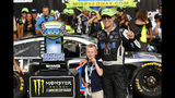 Kevin Harvick celebrates with his son, Keelan, after winning a NASCAR Cup Series auto race at Michigan International Speedway in Brooklyn, Mich., Sunday, Aug. 11, 2019. (AP Photo/Paul Sancya)
