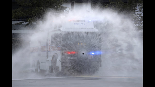 Hong Kong police demonstrate water cannon as protests linger | WFTV