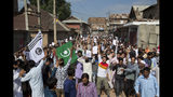 """Kashmiri Muslims shout slogans during a protest after Eid prayers during a security lockdown in Srinagar, Indian controlled Kashmir, Monday, Aug. 12, 2019. Hundreds of worshippers gathered after the prayers and chanted """"We want freedom"""" and """"Go India, Go back,"""" witnesses said. Officials said the protest ended peacefully. (AP Photo/ Dar Yasin)"""