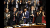 Italian Interior Minister and Deputy-Premier Matteo Salvini is applauded by The League party's lawmakers as he addresses the Senate in Rome, Tuesday, Aug. 13, 2019. Italy's political leaders scrambled to line up allies and form alliances Tuesday as the country's right-wing interior minister pressed his demands for an early election in the hope of snagging the premiership as a platform for his anti-migrant, euroskeptic agenda. Senators hastily summoned back from a vacation break convened for a vote on scheduling their consideration of a no-confidence motion lodged by Matteo Salvini's League party against Premier Giuseppe Conte's 14-month-old populist government. (AP Photo/Alberto Pellaschiar)