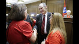 Sen. Mark Pody, R-Lebanon, talks with people attending a Senate hearing to discuss a fetal heartbeat abortion ban, or possibly something more restrictive, Monday, Aug. 12, 2019, in Nashville, Tenn. (AP Photo/Mark Humphrey)