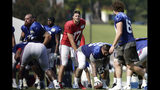 Buffalo Bills quarterback Josh Allen (17) takes a snap during an NFL football training camp with the Carolina Panthers in Spartanburg, S.C., Tuesday, Aug. 13, 2019. (AP Photo/Gerry Broome)