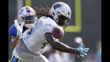Carolina Panthers' Temarrick Hemingway, right, reaches for pass with Buffalo Bills' Dean Marlowe defending during an NFL football training camp in Spartanburg, S.C., Tuesday, Aug. 13, 2019. (AP Photo/Gerry Broome)