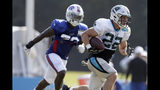 Carolina Panthers' Christian McCaffrey (22) runs while Buffalo Bills' Vosean Joseph chases during an NFL football training camp in Spartanburg, S.C., Tuesday, Aug. 13, 2019. (AP Photo/Gerry Broome)