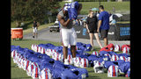 Buffalo Bills' Ed Oliver puts on his pads prior to an NFL football training camp with the Carolina Panthers in Spartanburg, S.C., Tuesday, Aug. 13, 2019. (AP Photo/Gerry Broome)